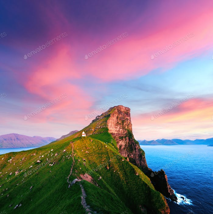 Incredible sunset landscape with Kallur lighthouse
