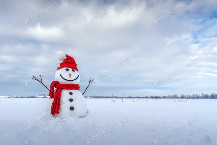 Lustiger Schneemann in rotem Hut