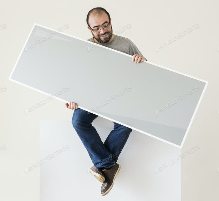 Man holding a blank banner