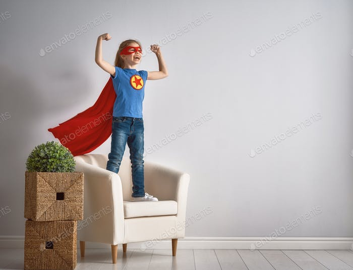 child is playing superhero