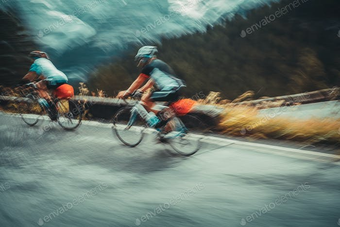 Two sportsmans on the bicycles