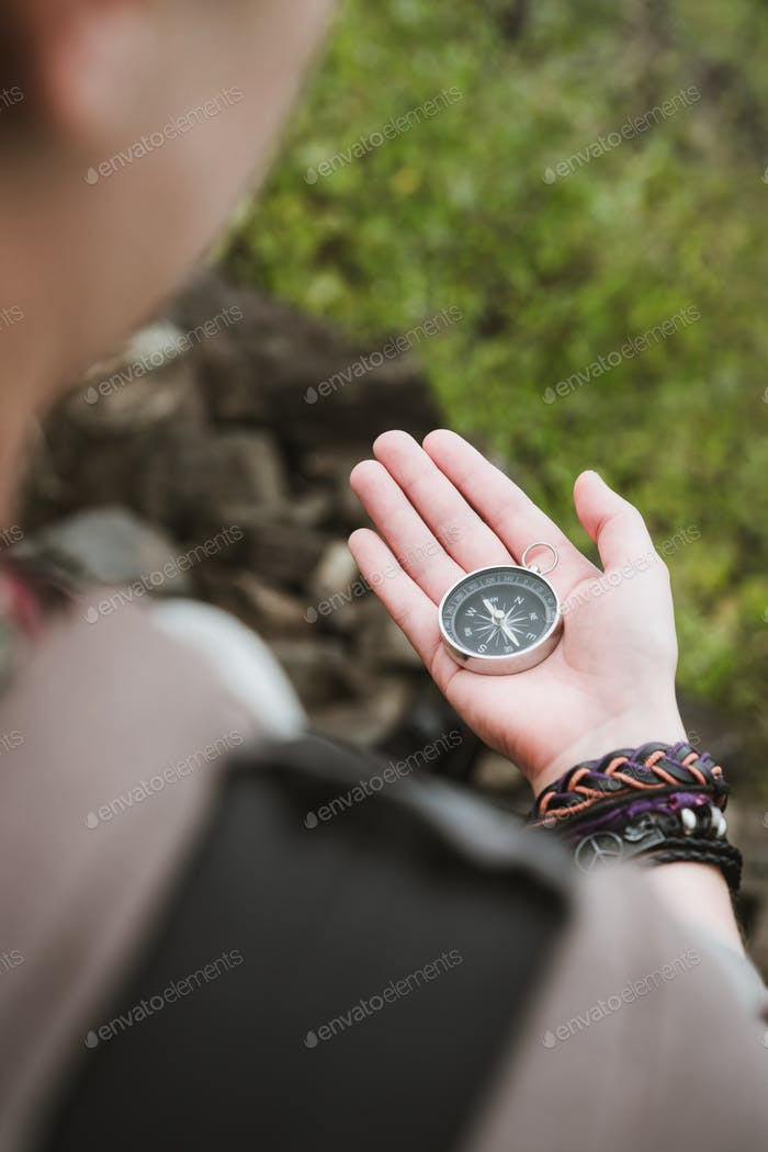 Women looked at the compass in her hand to find right direction