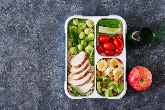 Healthy green meal prep containers with chicken fillet, rice, brussels sprouts, vegetables