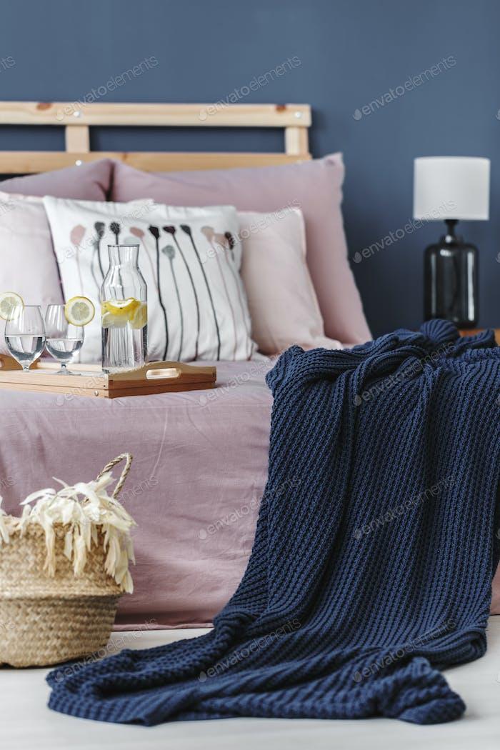 Blue blanket on bed