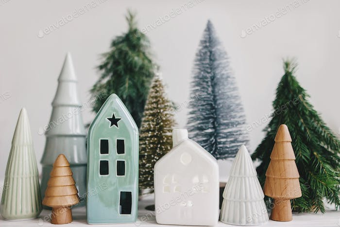 Christmas little houses and trees on white background