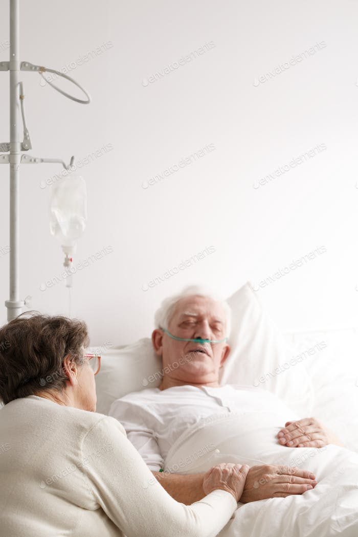 Senior man and his wife in hospital