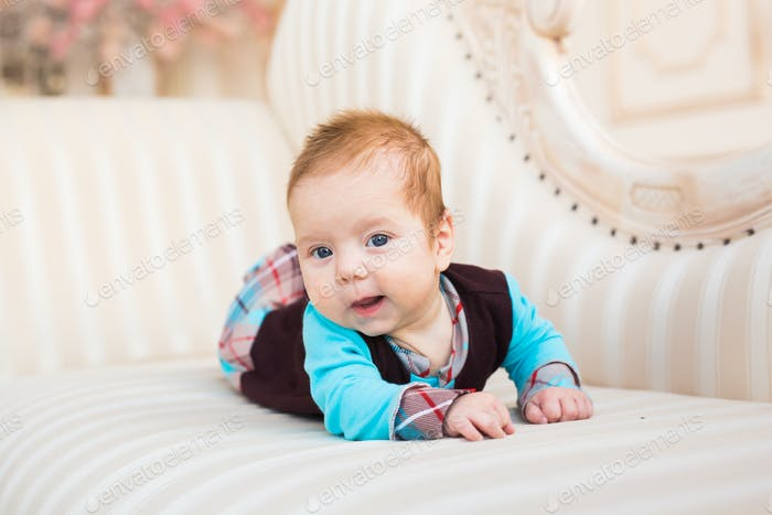 Cute baby boy, closeup portrait of adorable child, sweet toddler