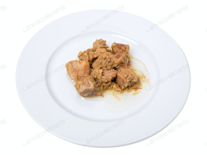 Stewed pork fillet with onions.