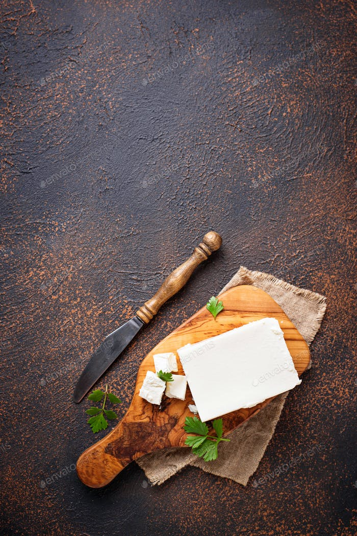 Feta cheese on rusty background