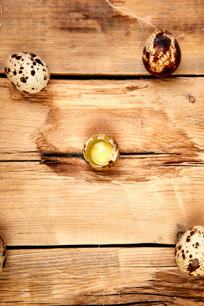 Quail eggs on wooden background. Happy easter.