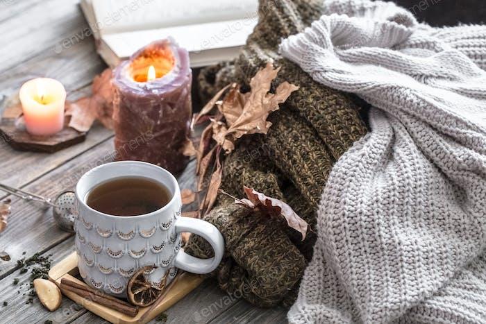 Steaming cup of hot coffee, tea standing near window. Fall.