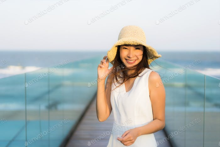 Portrait beautiful young asian woman happy and smile on the beac