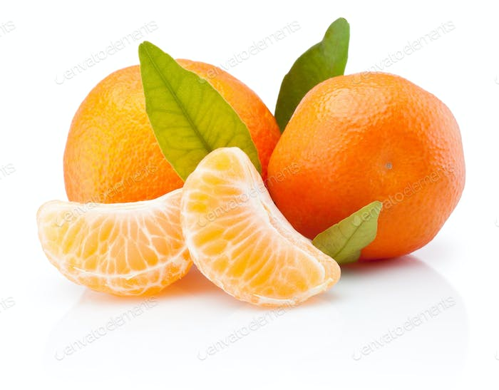 Two tangerines with leaves and peeled pieces isolated on white b