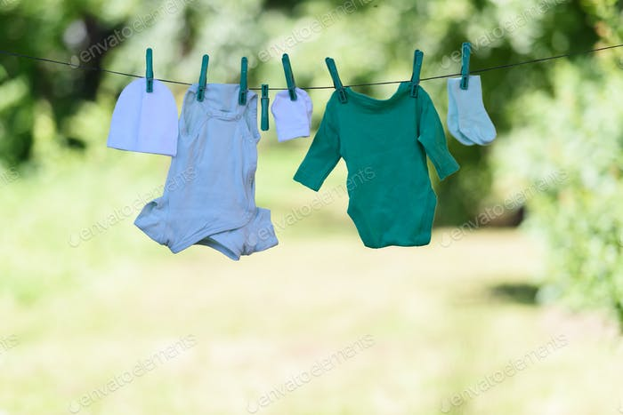 Baby clothes on clothesline in garden