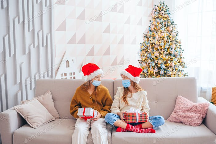 Happy kids holding christmas presents