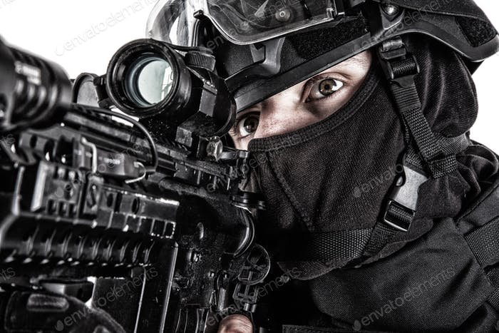 SWAT team fighter aiming rifle close up portrait