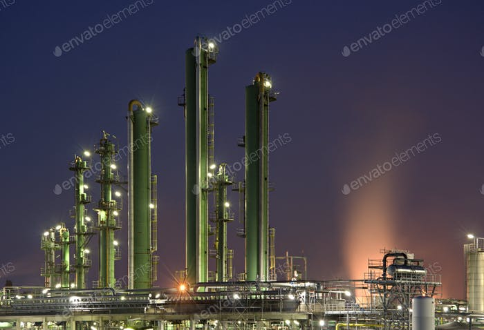 Refinery Towers With Purple Sky