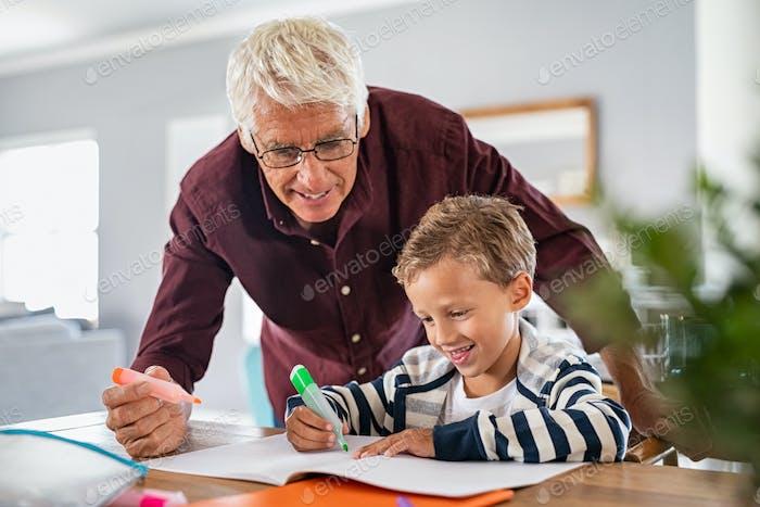 Grandfather help schoolboy doing homework