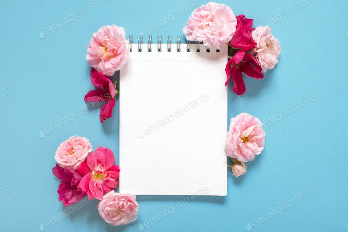 Blank Notepad and Fresh Roses