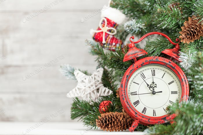 Christmas card with decorated fir tree and clock