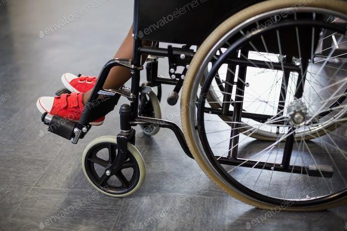 Boy sitting on wheelchair