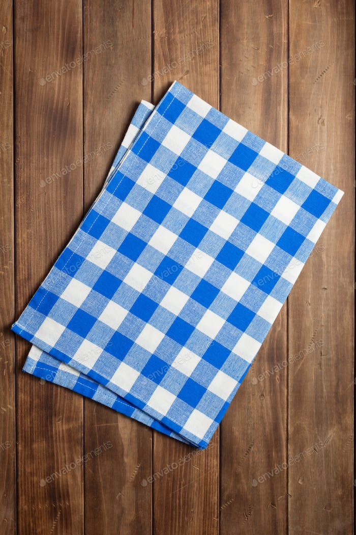 cloth napkin on at rustic wooden plank