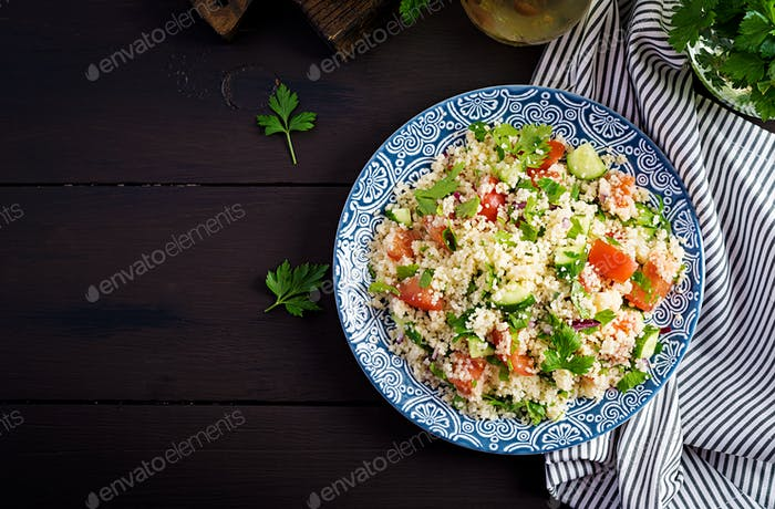 Traditional Lebanese Salad Tabbouleh. Couscous with parsley, tomato, cucumber
