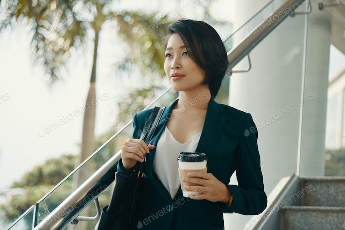 Businesswoman has a coffee break
