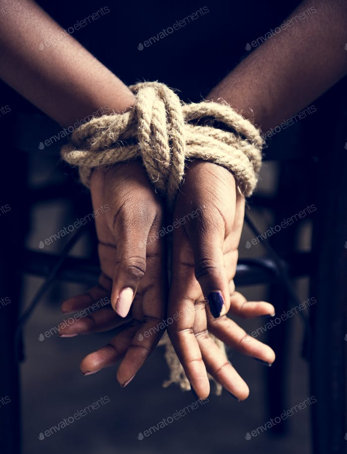 Woman hands tied up with a rope