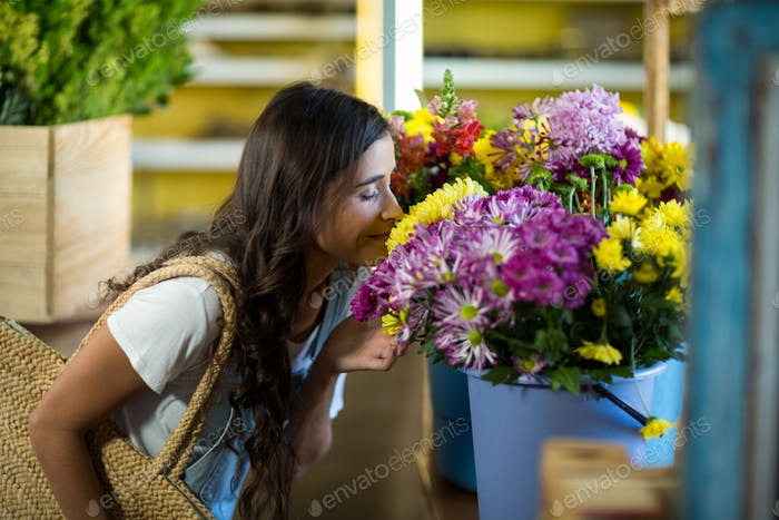 Woman smelling a bunch of flowers