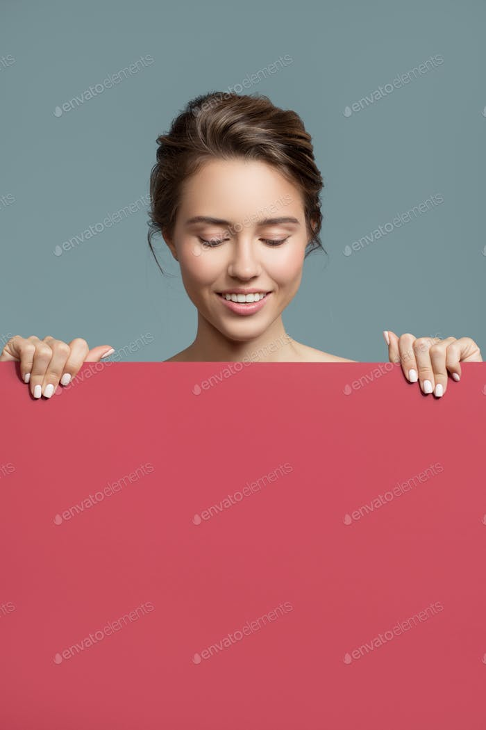 Attractive Smiling Woman Holding Red Empty Paper Blank