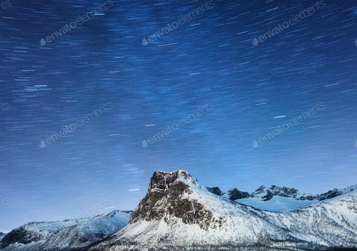 Night landscape wits stars trails on Lofoten islands, Norway. Winter landscape