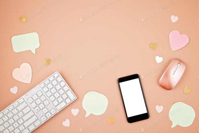 Social media concept flatlay with keyboard, phone, mouse