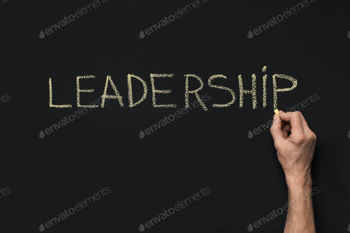 Word Leadership written with white chalk on blackboard