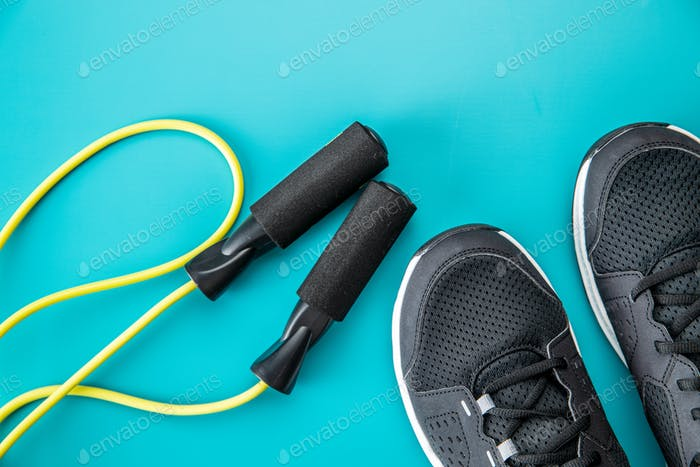 Black sport shoes and jump rope.