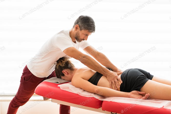 Osteopath during sacral loin procedure