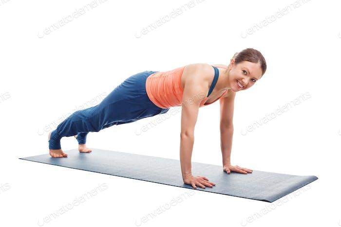 Woman doing yoga asana Utthita chaturanga dandasana (or phalakasana