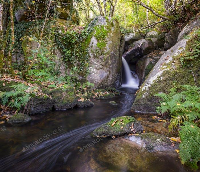 A small stream draws huge granite boulders