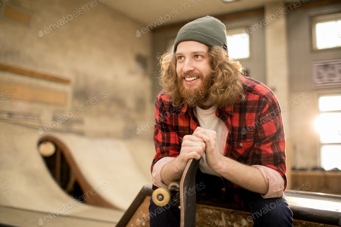 Bearded Young Man in Skate Park