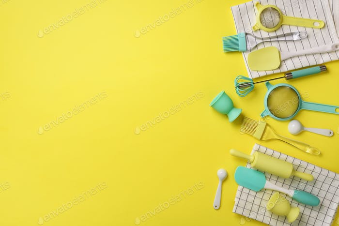 Time to cook. Turquoise cooking utensils on yellow background. Food ingredients. Cooking cakes and
