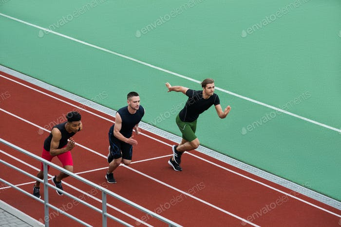 Concentrated multiethnic athlete group run