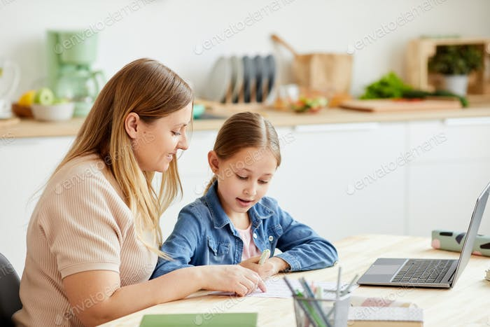 Cute Girl Enjoying Homeschooling with Mom