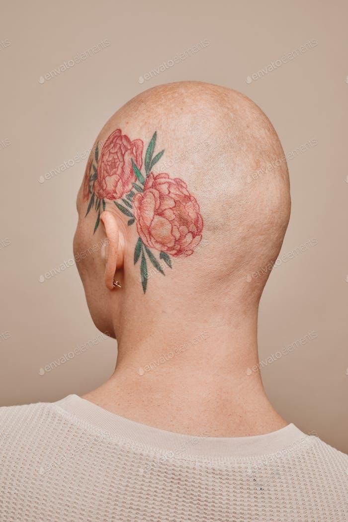 Bald Woman Wearing Head Tattoo