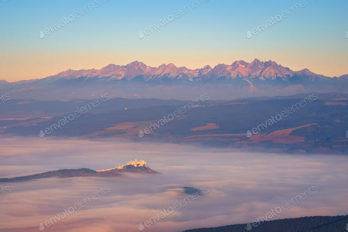 High Tatras mountain range and Spis castle at sunrise, Slovakia
