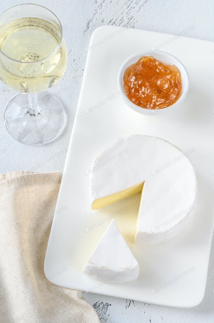 Camembert cheese with glass of wine