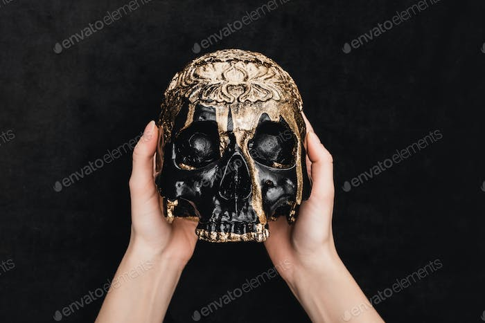 Top View of Witch Holding Voodoo Skull on Black