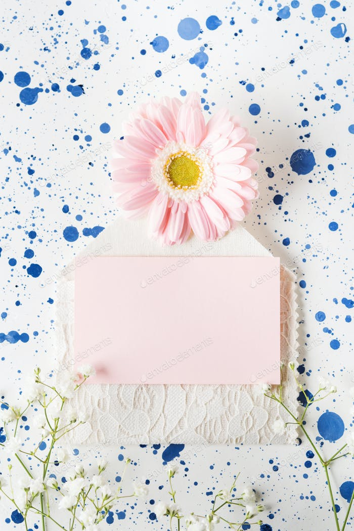 Blank pink card and flowers. Mockup