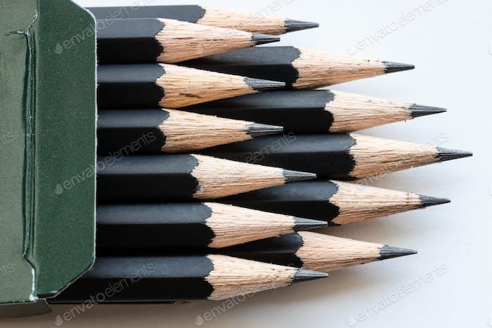sharp tips of set of black graphite pencils