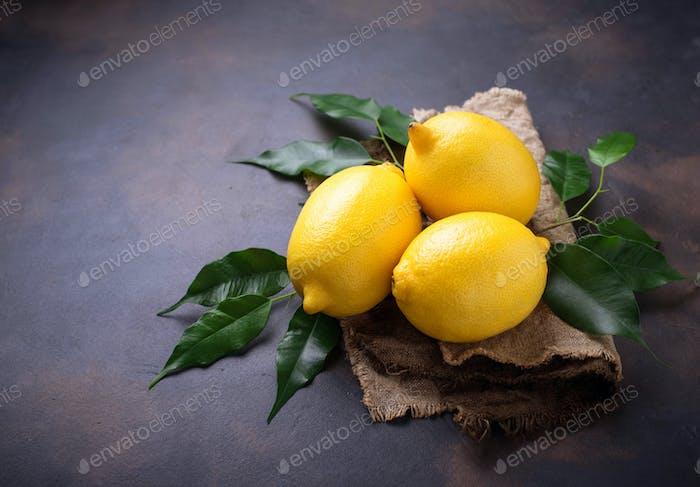 Fresh juicy lemons on rusty background