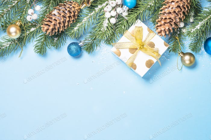 Christmas background - fir tree and decorations on blue top view
